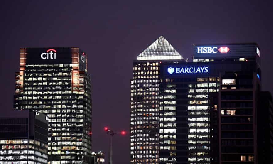 Office blocks of Citi, Barclays, and HSBC banks at dusk in the Canary Wharf financial district in London