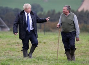 The prime minister had to don his wellies as he was shown around Darnford Farm by farmer Peter Watson.