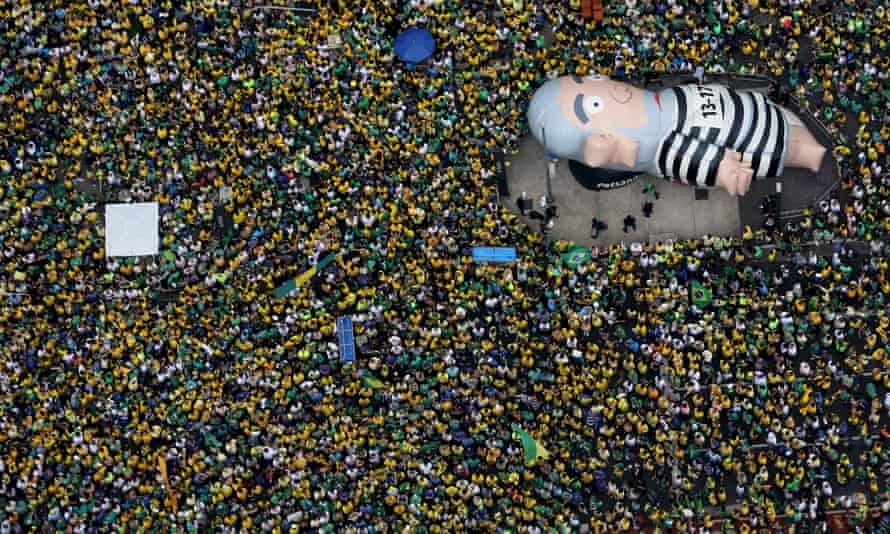 """An inflatable doll known as """"Pixuleco"""" of Brazil's former President Luiz Inacio Lula da Silva is seen during a protest against Rousseff, part of nationwide protests calling for her impeachment."""