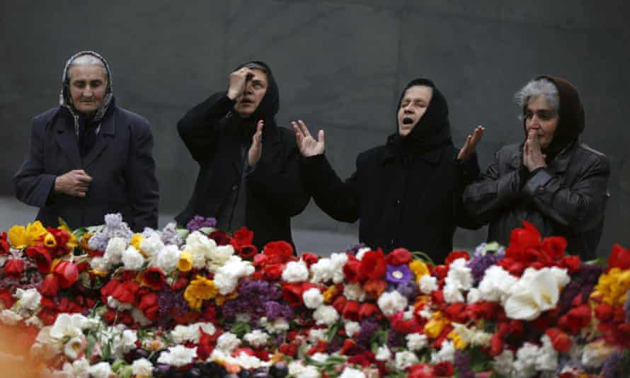 People mourn at the Armenian Genocide Memorial Museum in Yerevan, Armenia on Tuesday.