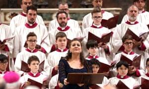 Mezzo-soprano Cecilia Bartoli joins the male choir at the Sistine Chapel on Friday.
