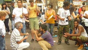 """<strong>Capoeira at Notting Hill 2015</strong><br>Getting psyched up for capoeira, a Brazilian martial art that combines dance, acrobatics and music with its roots in West Africa<br>Photograph: <a href=""""https://witness.theguardian.com/assignment/55deeea5e4b0778f0c23e764/1688877"""">Meganmct10/GuardianWitness</a>"""