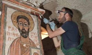 Stephen Rickerby carrying out conservation treatment in one of the painted churches.