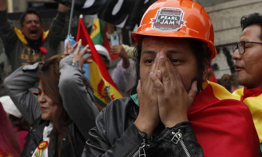 Opponents of Morales celebrate his resignation in La Paz.