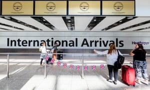 People arriving at Heathrow terminal 5.