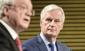 EU negotiator Michel Barnier listens to Brexit secretary David Davis at a press conference in Brussels.