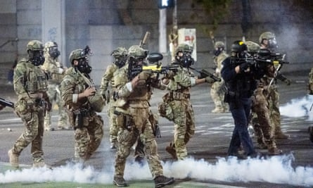 Federal officers use teargas and projectiles on crowds of protesters in Portland, Oregon Sunday.