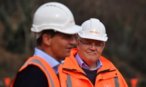 two white men in hard hats and fluoro safety vests