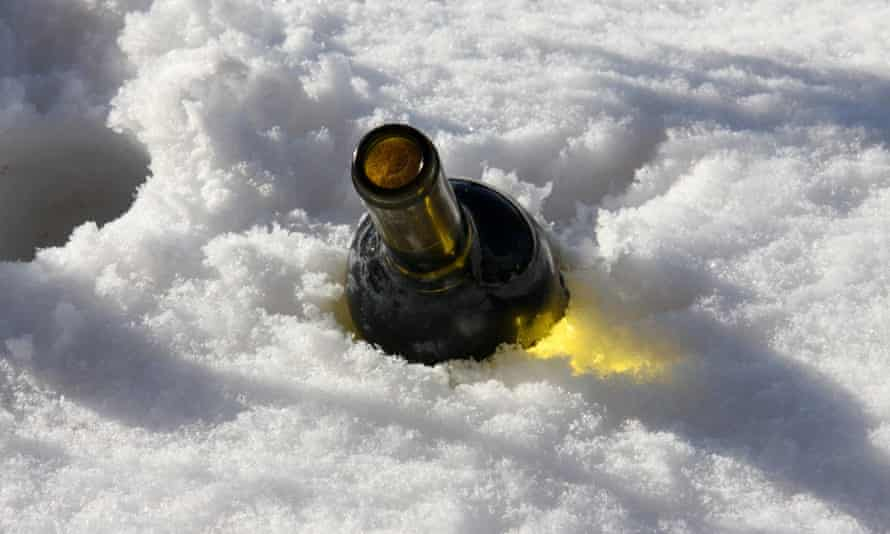 Bottle of wine chilling in snow