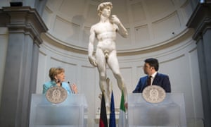 German Chancellor Angela Merkel and Italian Prime Minister Matteo Renzi hold a press conference in front of Michelangelo's statue of David