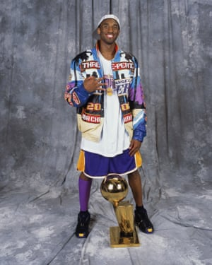 Bryant poses solo with the NBA trophy in 2002 after the Lakers achieved a three-peat.