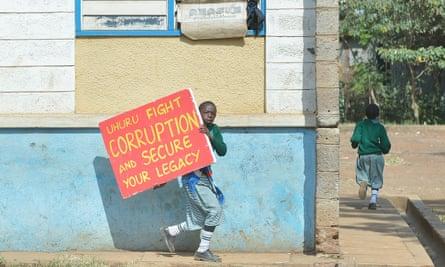 Schoolchildren flee tear gas in Nairobi after police break up a protest.