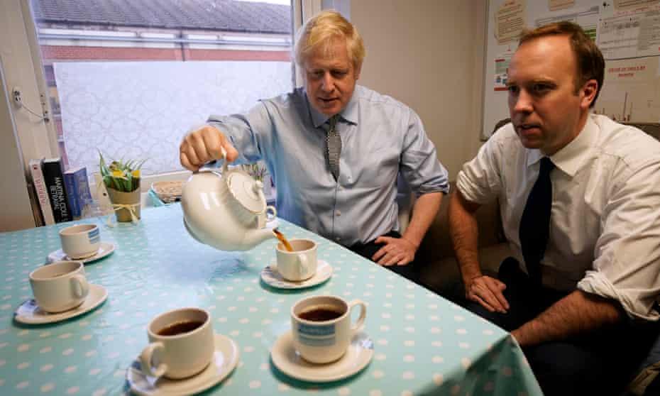 Boris Johnson and Matt Hancock share some tea in 2019.