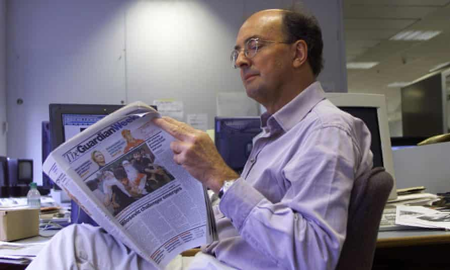 Patrick Ensor, former editor of the Guardian Weekly sat at a desk