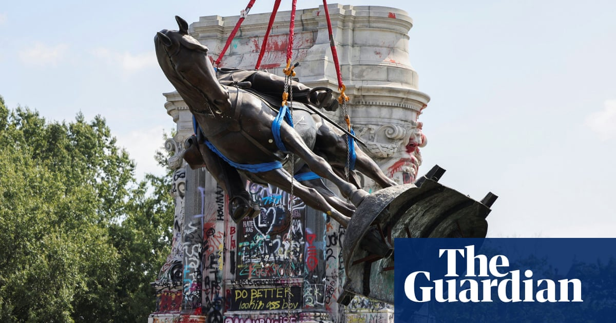 Removal of Confederate statue greeted with cheering in Virginia – video