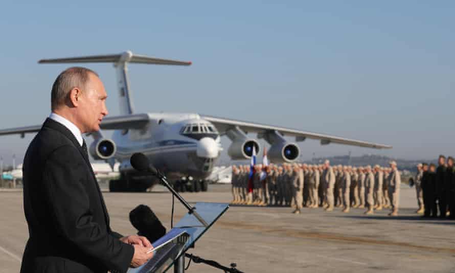 Russian president Vladimir Putin addressing troops at the Hemeimeem air base in Syria on Monday