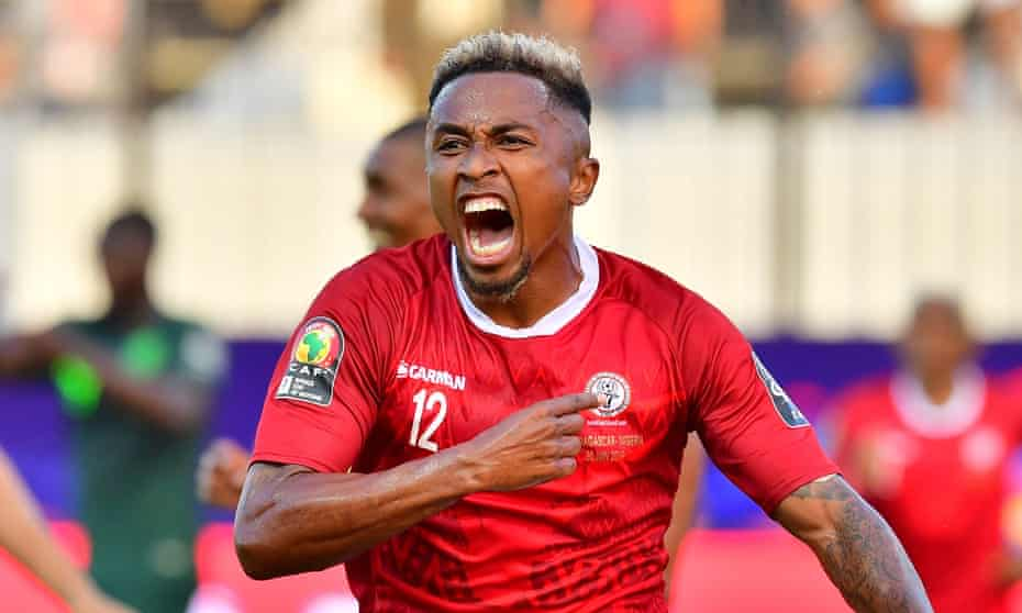 Lalaïna Nomenjanahary celebrates scoring Madagascar's first goal against Nigeria in their Africa Cup of Nations match in Alexandria