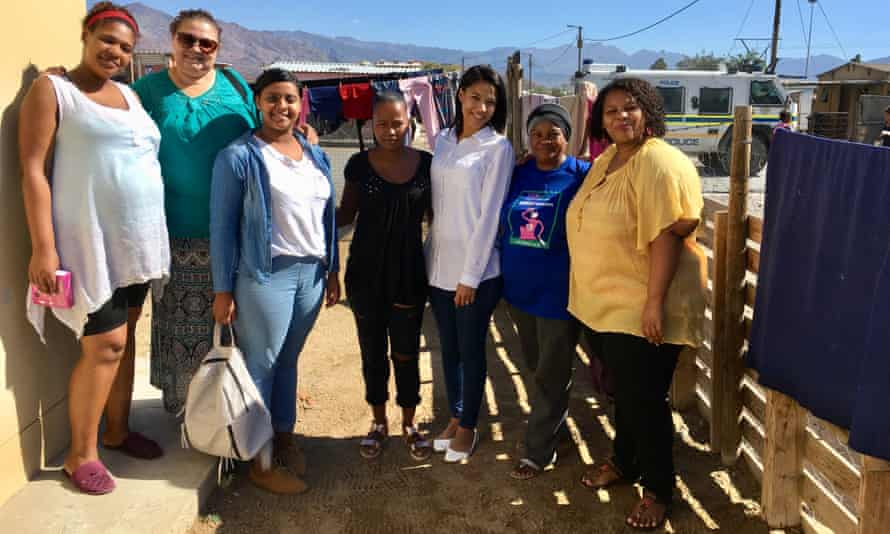 Charay Afrika, far left, and Abigail, centre, in Esselen Park township with other mentor mothers and social workers.