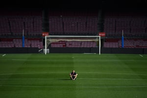Iniesta sits on the pitch, late after his final Barcelona match.