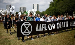 Extinction Rebellion activists marching through east London.