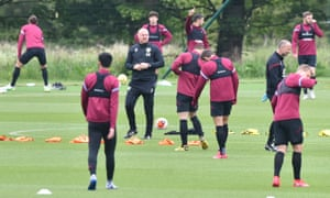 Sean Dyche (centre) supervises training as Burnley prepare for the restart of the Premier League.