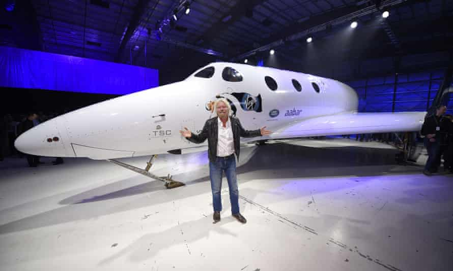 Sir Richard Branson poses in front of Virgin Galactic's SpaceShipTwo space tourism rocket after it was unveiled on Friday in Mojave, California.