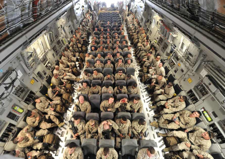 US service personnel on a plane bound for Afghanistan
