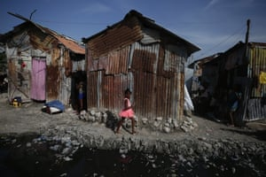 A girl walks past a pool of water used as a toilet by residents in the Cite Soleil district of Port-au-Prince, Haiti. Residents say access to basic services, jobs, and security has been declining.