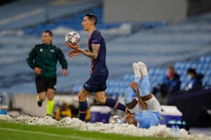 Paris St Germain's Angel Di Maria after clashing with Manchester City's Fernandinho.