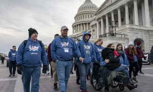 As the impeachment trial of Donald Trump is conducted inside the Senate, activists attending the March for Life anti-abortion rally visit the Capitol in Washington on Thursday.
