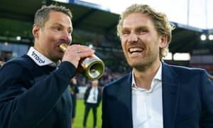 Brian Priske, head coach, and Rasmus Ankersen, president, celebrate Midtjylland's title success in July
