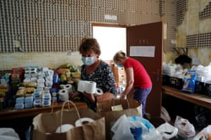 Volunteers work at East Algarve Families in Need Food Bank, during the coronavirus pandemic in Tavira, Portugal, on 31 March, 2021.