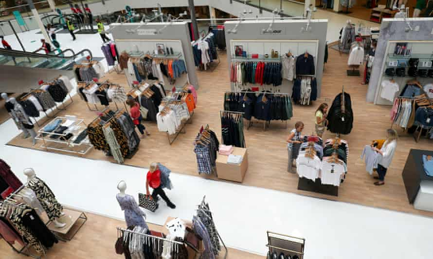 Customers look at clothing in the John Lewis store in Kingston upon Thames.