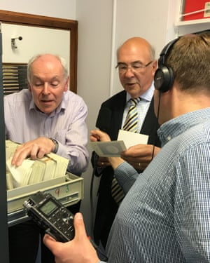 Carl Murray and Garry Hunt being recorded as they look through the Voyager image archive at Queen Mary University of London.