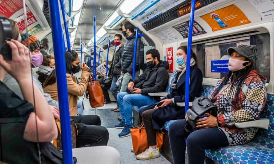 Masked travellers on the London underground