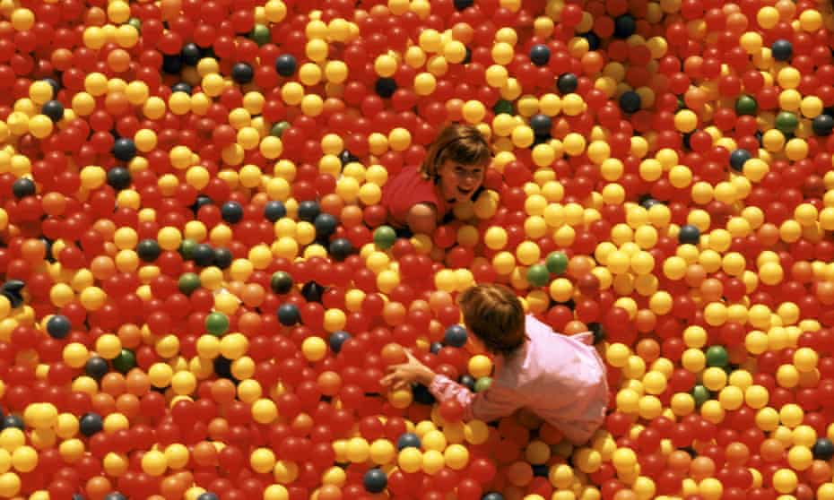children playing in plastic ball pit