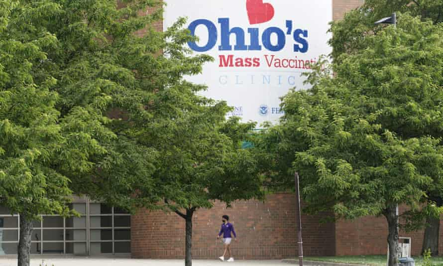 A man walks past Ohio's Covid-19 mass vaccination clinic at Cleveland State University. The first winner in the state's Vax-a-Million program was announced.
