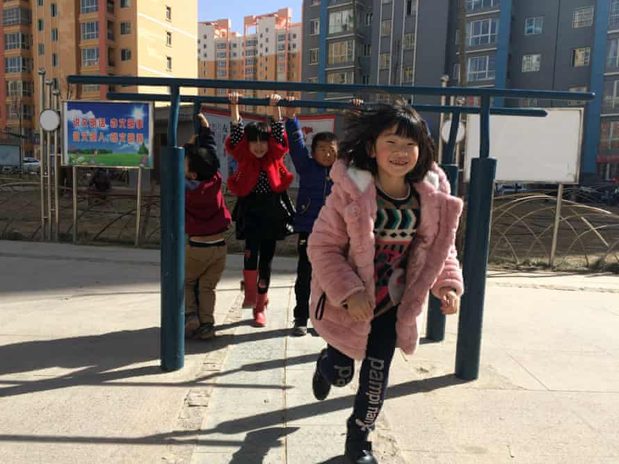 Children playing in Rainbow Town, busiest part of Lanzhou New Area.