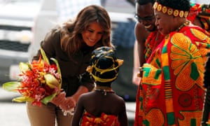 Melania Trump greets a child during her visit to Cape Coast castle, Ghana, on 3 October.