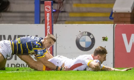 Catalans' Tom Davies catches Leeds cold with the first try at the Halliwell Jones Stadium.