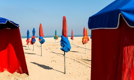The beach of Deauville, Normandy, with typical beach umbrellas