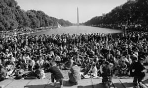 View of anti-Vietnam war protestors around the Lincoln Memorial reflecting pool on 21 October 1967.
