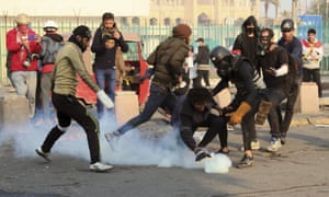 Riot police fire teargas to disperse anti-government protesters in Baghdad, Iraq, on Saturday 25 January.