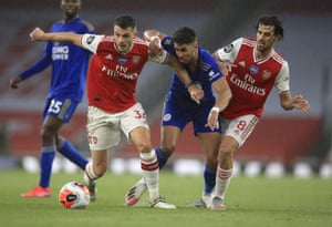 Leicester's Ayoze Perez (centre) tussles with Arsenal's Granit Xhaka (left) and Dani Ceballos.
