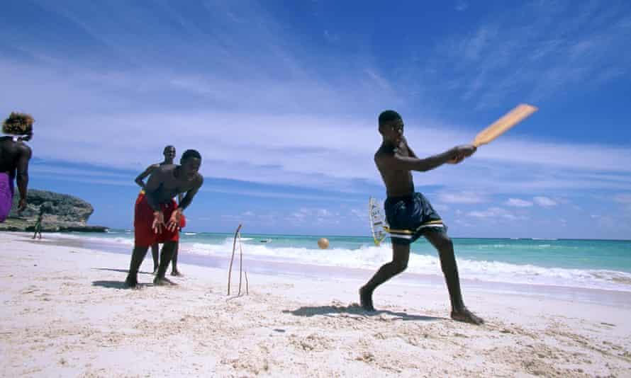 Boys play cricket on the beach in Barbados