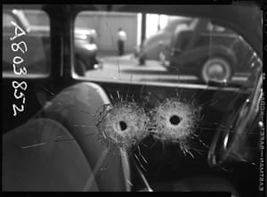 Forensic detail of bullet holes in a car window – 1942