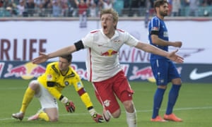 Leipzig's Emil Forsberg wheels away in celebration after opening the scoring against Karlsruhe in the 2-0 win that earned the home side promotion to the Bundesliga.