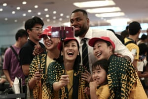 Australia's Samu Kerevi poses for a selfie with Wallabies fans after the team's arrival at Haneda airport in Tokyo.