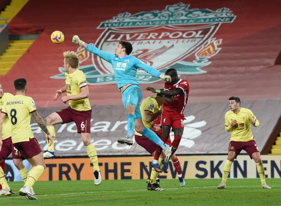 Burnley goalkeeper Nick Pope comes out to punch the ball clear.