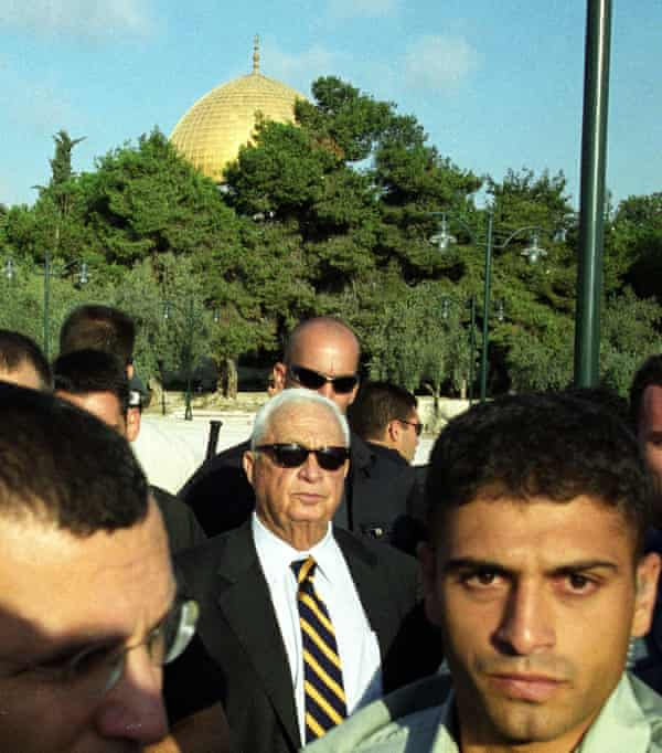 Right-wing opposition leader Ariel Sharon (C), flanked by security guards, as he visits the Al-Aqsa mosque compound in Jerusalem's Old City on 28 September 2000.